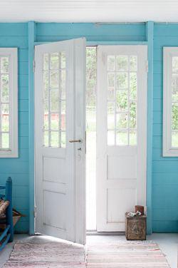 white door blue wall